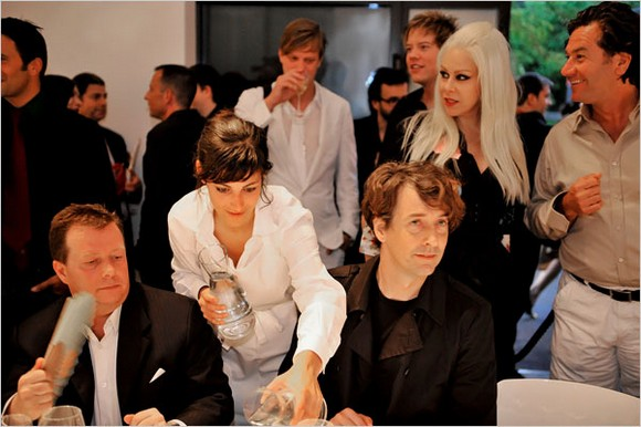 """""""Every year days before Art Basel, the highest-profile event on the jammed calendar of international art fairs, members of the art world's inner circle gathered in Zurich for a dinner in the concrete, bunkerlike storage room of a luxury fashion store.""""  Art Basel art parties 23496611"""
