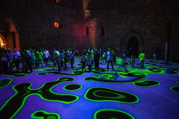a kaleidoscope of colors  13th century castle courtyard lightened up with psychedelic lights Psychedelic lights modern artists contemporary art colors