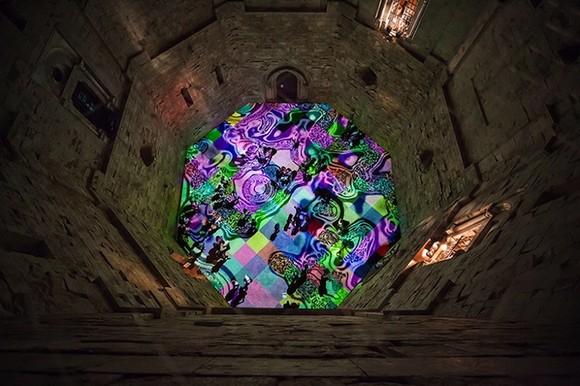a kaleidoscope of colors  13th century castle courtyard lightened up with psychedelic lights Psychedelic lights modern artists contemporary art